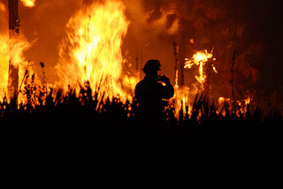 Firefighter in front of wildfire. (Creative Commons image by U.S. Fish and Wildlife Service Southeast Region on Flickr)
